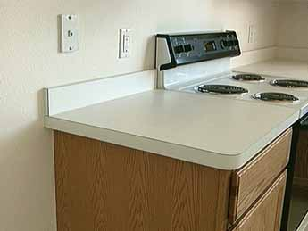FLAT LAID COUNTERTOPS Can Be Fabricated In A Shop Or On Site. See PLASTIC  LAMINATE COUNTERTOP And POST FORMED COUNTERTOP.
